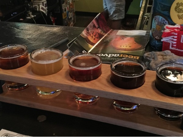 Enjoy a flight of beer at a great local Fayetteville Brewery, Fossil Cove
