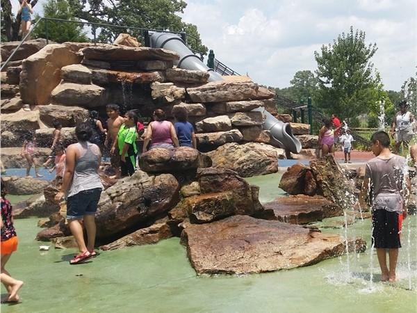 War Memorial Park Splash Pad. Waterfall, slides, hidden tunnels, and lots of sprinklers