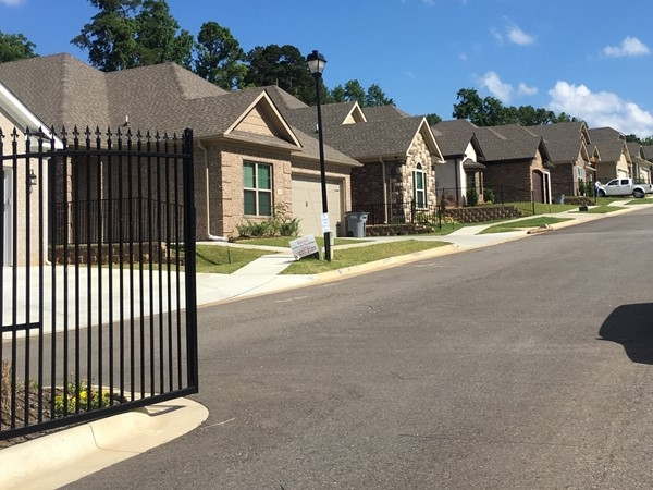 Gated entrance and some of the homes in Hunter Crossing subdivision in Bryant