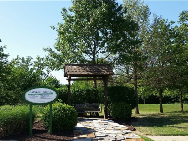 One of many green spaces and park type areas in this delightful and desired Rogers subdivisions