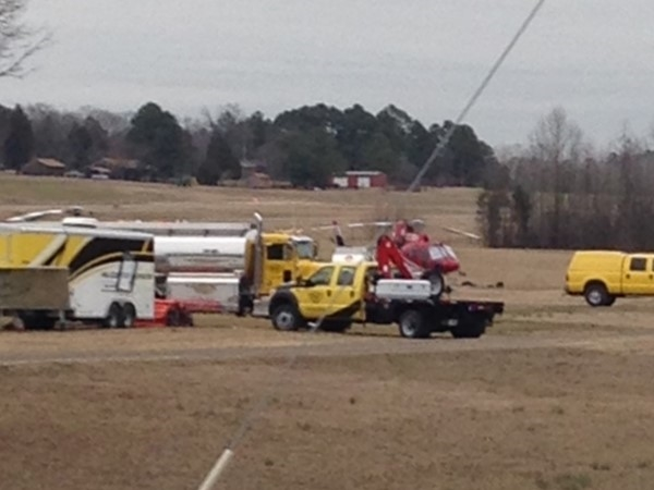 Activity at the Clarksville Airport. Red helicopter in the background