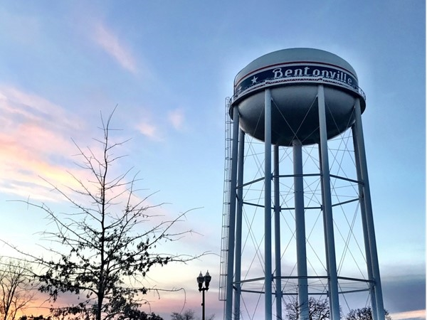 The colors of the sky are beautiful with the Bentonville water tower