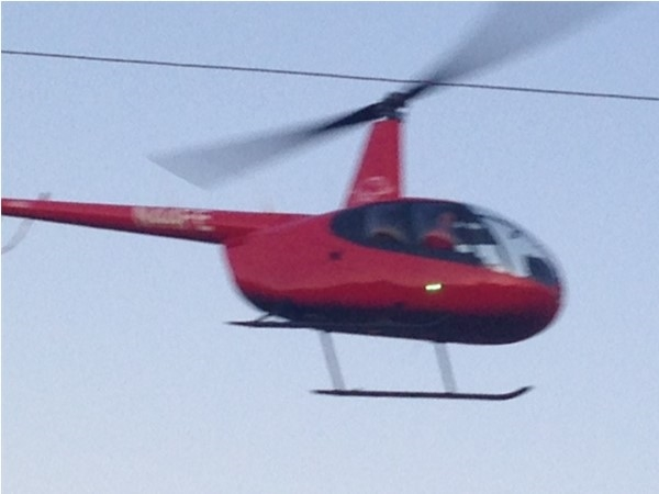 Chopper Pilot preventing frost from forming on Peach Trees
