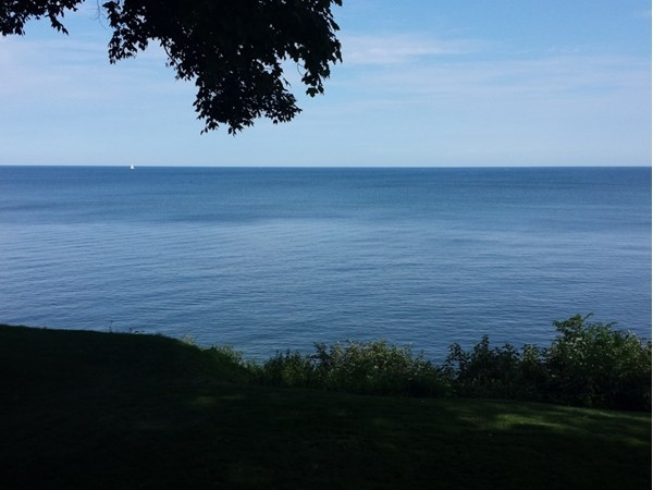 View of Lake Ontario. Look close and see a sailboat in the distance.