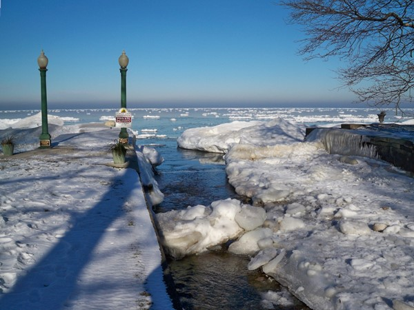 The mouth of Shipbuilders Creek as it flows into Lake Ontario in early spring