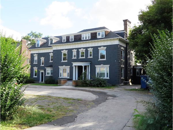 Large brick mansion converted to ten high-end apartments on Lake Avenue in Rochester