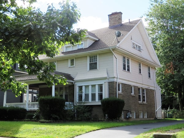 Two and a half story home with large front porch on Seneca Parkway off Lake Avenue in Rochester