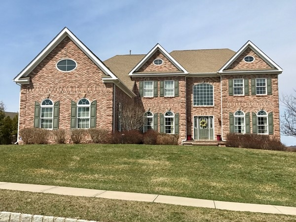 Stately brick Custom Colonial located in the Estate of Briarcliff in Monroe