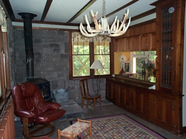 Cozy den in the historic house on Main Street in Naples. Notice the antler light fixture