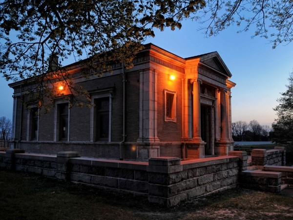 This beautiful stone building is the Gatehouse at the Highland Park Reservoir