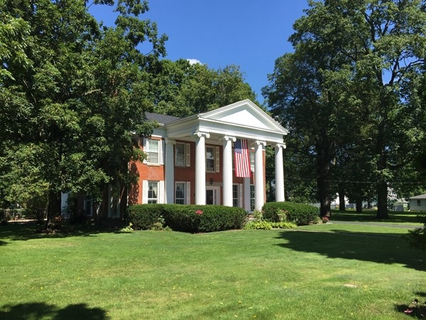 Stately, brick colonial with a columned front porch in Mt. Morris