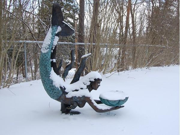 Garden statue with snow