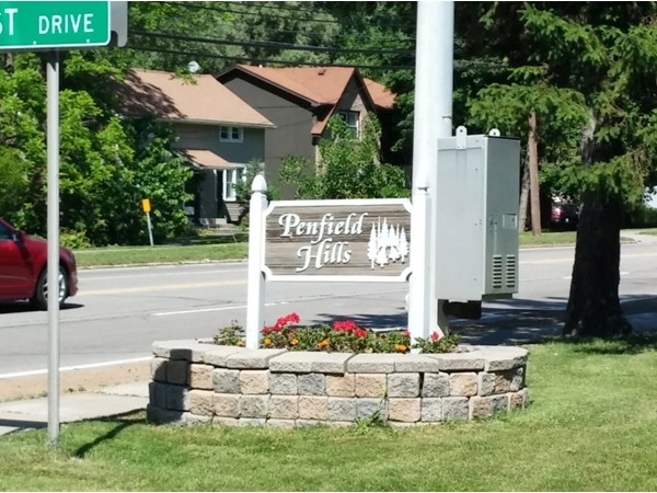 Our neighborhood welcome sign, maintained by the Penfield Hills Garden Club