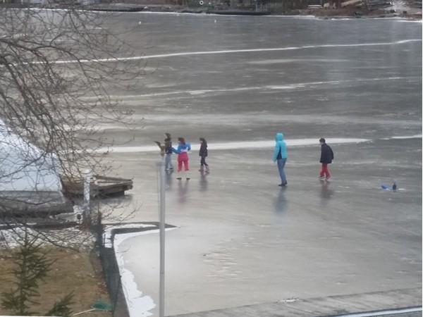 Local children enjoying the frozen lake