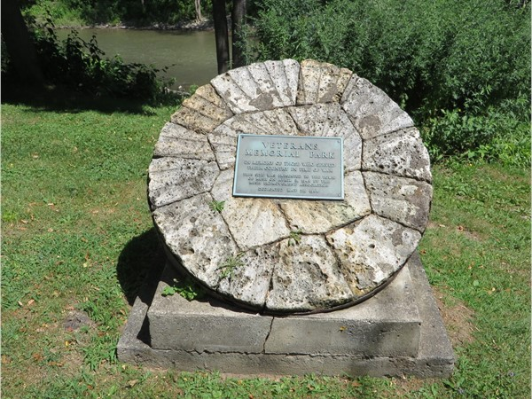 Mill grist stone with the plaque for the Veterans Memorial Park in the hamlet of Rush