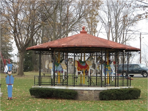 Band shell in a park in the Village of Palmyra with carousal Holiday props