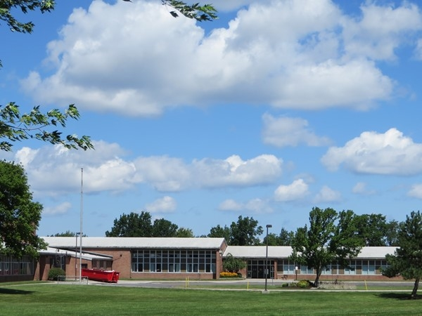 Elementary school in Henrietta with a beautiful sky and clouds