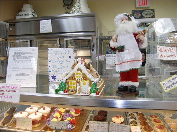 Sweet Delites Bakery features handmade gingerbread houses in December