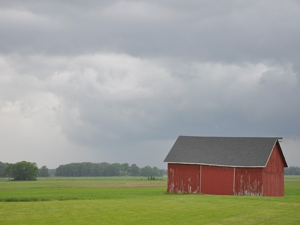 Storm clouds gathering over a barn on Rafferty Road, King Ferry NY