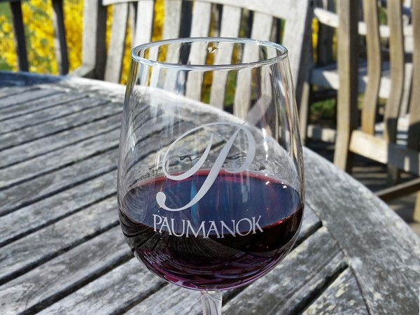 Have a glass of wine with friends at Paumanok Vineyards