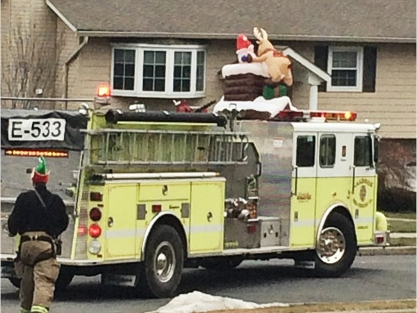 Local fire department delivering candy canes in the neighborhood