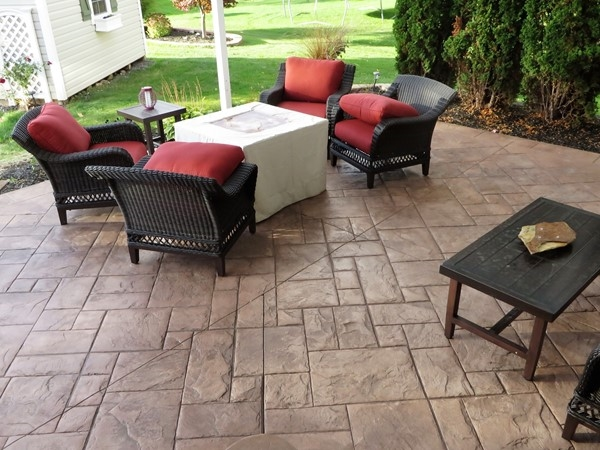 Beautiful stamped concrete patio at this home in Fairport