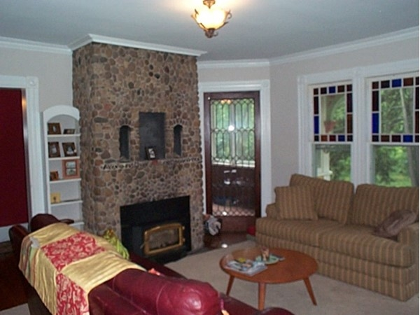 Unusual fireplace is the focal point of the living room of this historic home on Main St in Naples