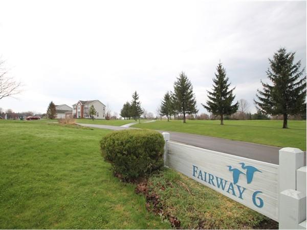 Residents of Gananda enjoy a backyard view of Fairway 6