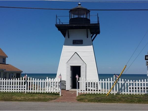 Replica Lighthouse along the shore of Lake Ontario near the mouth of  Eighteen Mile Creek