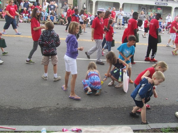 Better than Halloween - children gathering candy thrown by fourth of July Parade participants