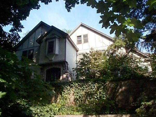 Large tudor home on Higland Avenue backing up to Cobbs Hill