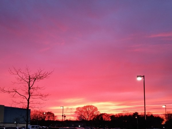 Fall sunset outside the local movie theater in Holtsville