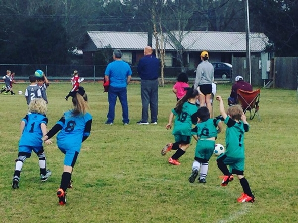 Children play in a spring soccer game at Relay Park. The Petal YMCA offers many family activities