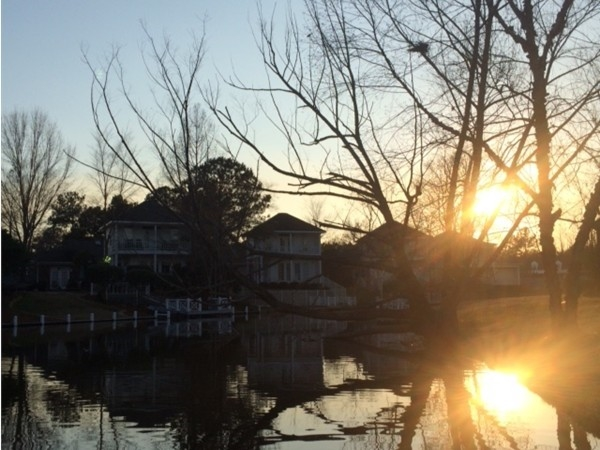 Enjoy serene sunset views from you back porch overlooking the beautiful lake in Lakeshore