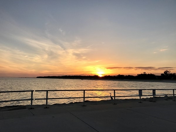 Watching a beautiful sunset at Pass Christian Harbor with my family