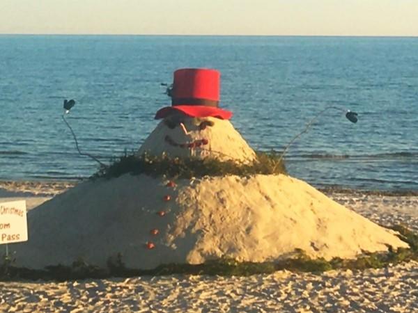 Sand snowman on the beach