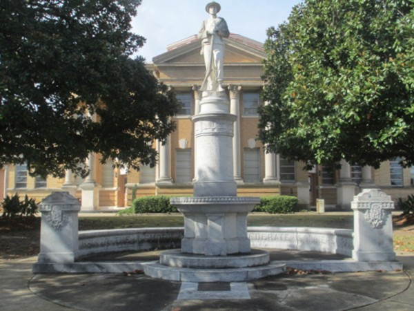Confederate Soldier Monument standing tall in front of court house in Hazlehurst