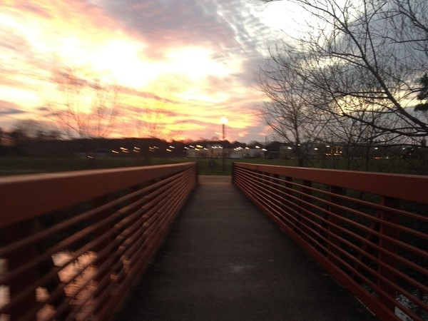 Sunset over the bridge at the Liberty Park walking trail