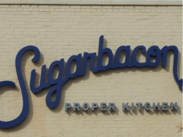 Sugarbacon Proper Kitchen offers salads, shrimp, burgers, and of course bacon