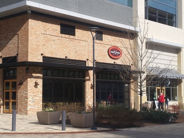 Coal Vines is a pizza, pasta and wine bistro located next to Top Pot Doughnuts