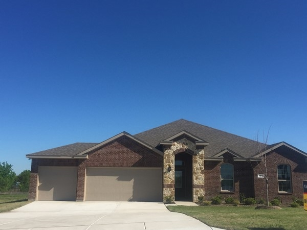 Brand new homes with 3 car garages and 1/2 acre lots near Lake Lavon