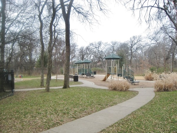 Playground and walking paths by Rowlett Creek