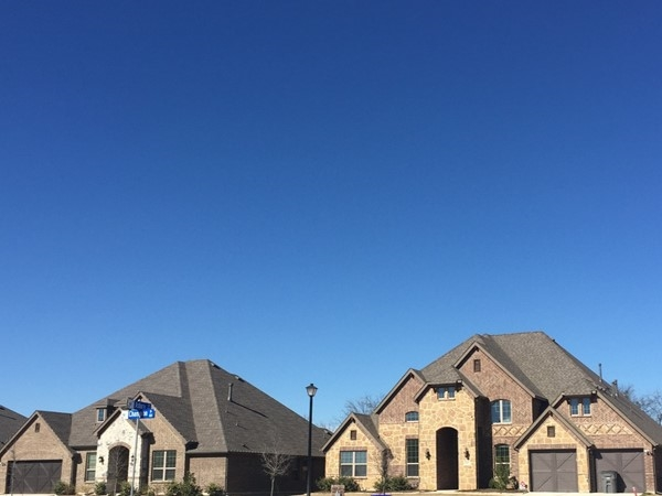 Altura Homes have cedar garage doors and stone with brick elevations!