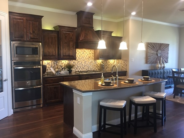 Lennar Homes main house kitchen in the Multi-Generaltional home is stunning
