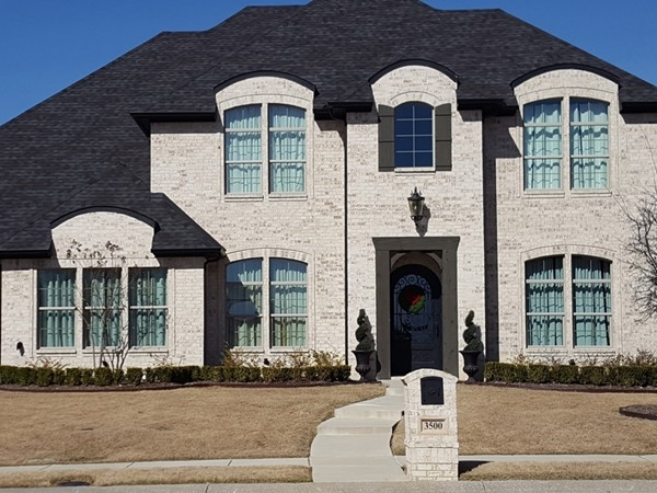 One of the many custom homes in The Bluffs At Winding Creek