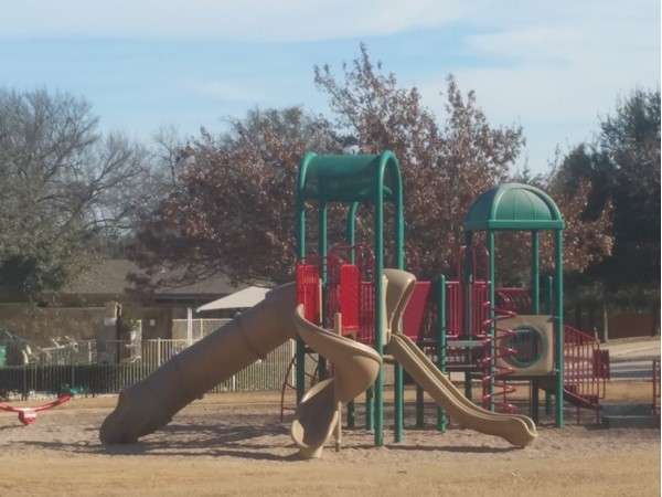 Playground area in 1/2 acre open space next to pool enclosure
