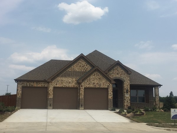 New model home for Altura Homes ! Love the 3 car garages