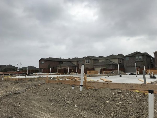 The newest home sites have cement poured and are ready to build
