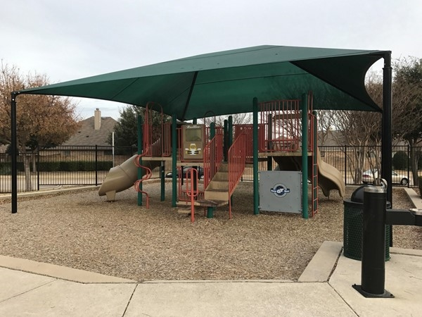A nice, covered playground area is close to the swimming pool