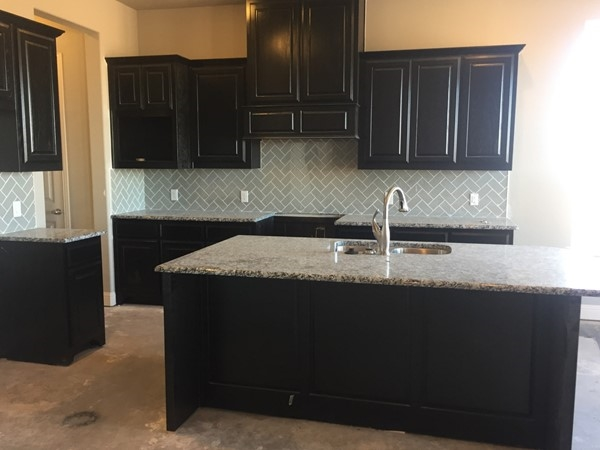 Model home kitchen in Oakdale homes is almost finished